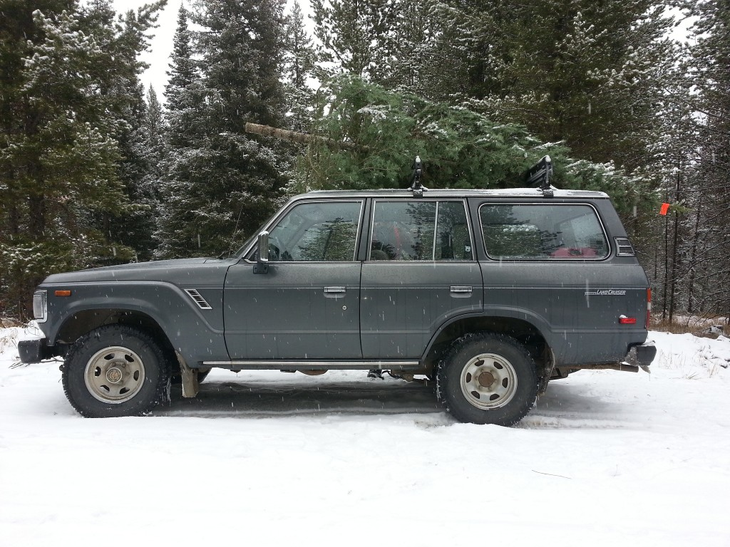 1990 Toyota Landcruiser FJ62 with Christmas Tree atop Roof